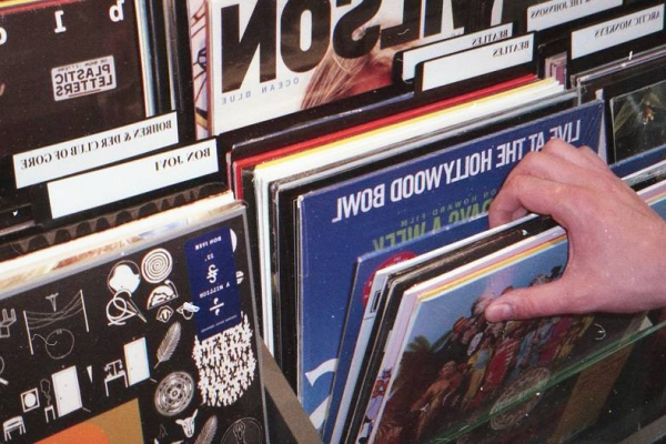 Hand sifting through some vinyl records.